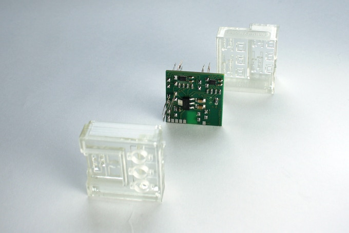 There are three connector holes and one power source port located on the underside of the SBrick.  The electronics and the identifying LED are in the middle. The top has four PF control ports.