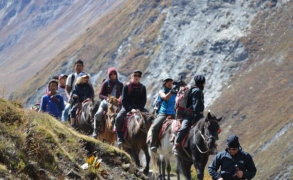 Filming while on horseback in the middle of the Himalayas.