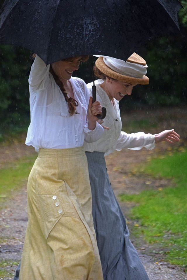 Victoria Rigby (Grace Crowder) and Tiffany Haynes (Violet Pearson) make a dash through a summer shower before the storms of war truly break.