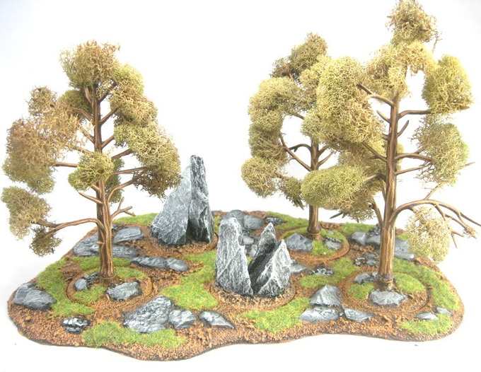 Rocky outcropping and tree stump inserts (with Woodland Scenic Trees) in an Area Terrain Base 5.2