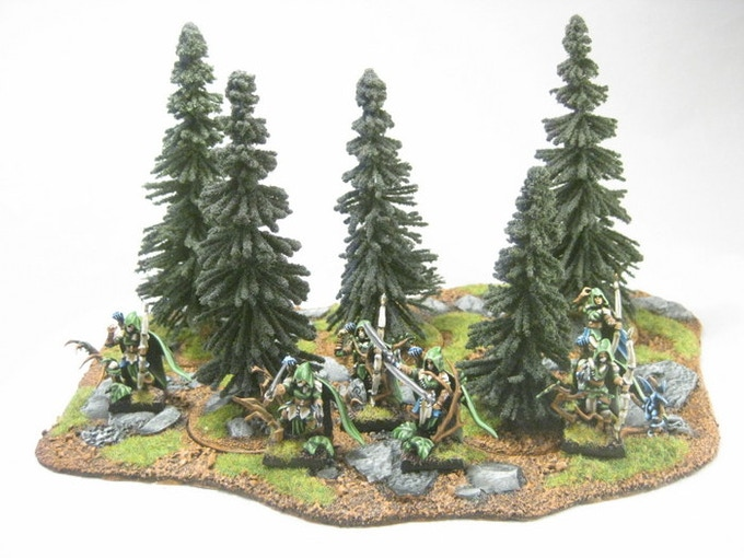 Tree stump inserts (with Spruce Trees from JTT Scenics) in an Area Terrain Base 5.2