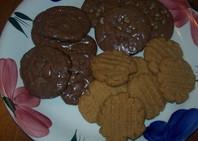 Gluten/Grain/Diary Free Dark Chocolate (a meringue type cookie with a chewy fudgy center) and Gluten/Grain/Diary Free all natural Peanut Butter Cookie (first attempt).