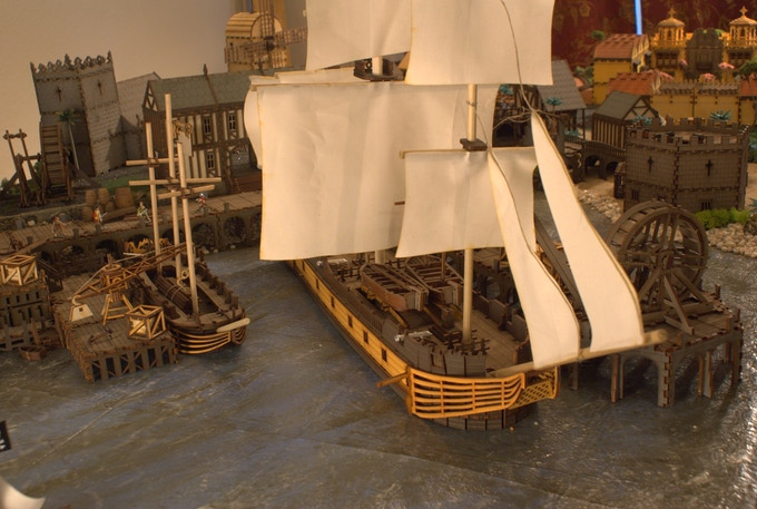 """The ship on the right is 33"""" long - a full 28mm model of HMS Surprise."""