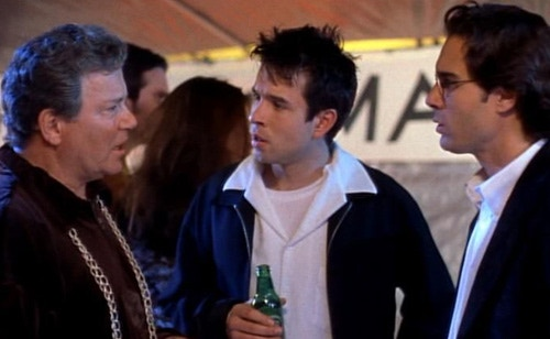 MAN ON A (FIVE YEAR) MISSION: Bill (WILLIAM SHATNER) tries to convince Mark (ERIC MCCORMACK) and Rob (RAFER WEIGEL) that there's more to life than Star Trek in the original FREE ENTERPRISE movie.