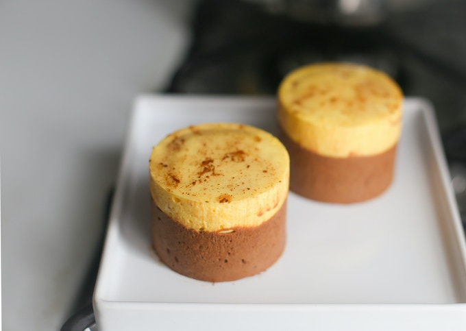 Mango-Passionfruit Chocolate Entremet: Chocolate cake base soaked in jasmine syrup with dark chocolate mousse, lychee gelée, and mango-passionfruit mousse dusted with cocoa powder and topped with neutral glaze
