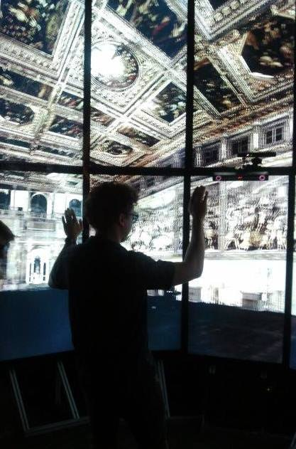 Vid walking visitors through a point cloud of Florence's Palazzo Vecchio in an immersive environment with the point cloud software he developed at the Qualcomm Institute, the UCSD branch of Calit2