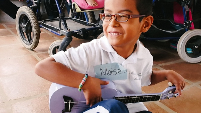 Moises in Nicaragua with one of the ukuleles we gave to his school.