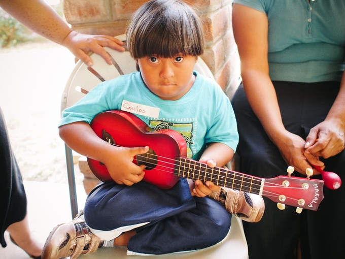 Carlos in Nicaragua trying out the Ukulele.