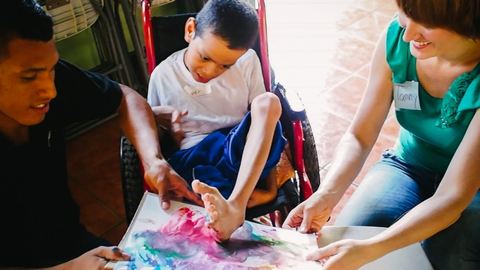 """Finger painting"" with his feet - he loves it!"