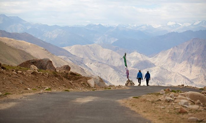 Aparna, the first Indian woman to ever take on a 135-mile race through the Himalayas and Rebecca start their ascent down Warila. Ladakh, India.