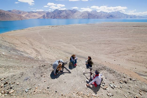 The production team interviewing Thenlis, the first female Ladakhi mountain guide next to Pangong Tso Lake. Ladakh, India