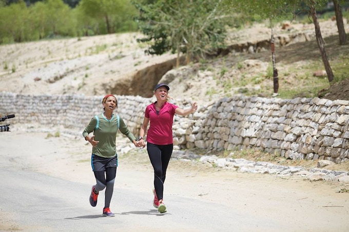 Aparna and Rebecca at the end of a 135-mile race that touches nearly 18,000 feet in elevation in the Himalayas. Ladakh, India