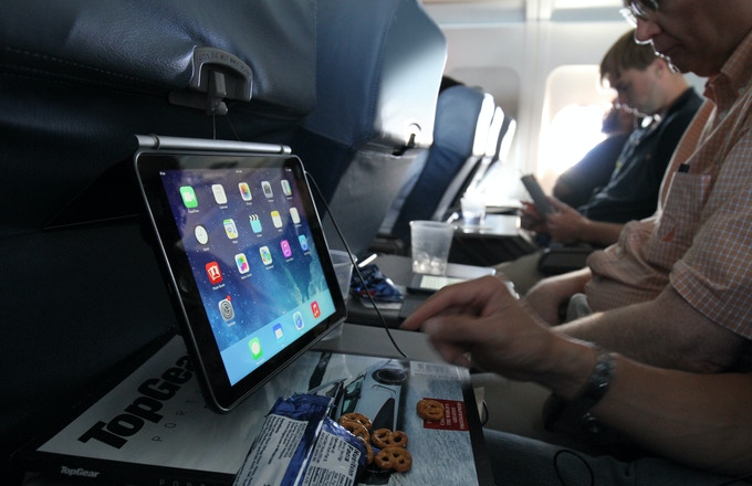 Loop it on the airplane seat in front of you to free up space