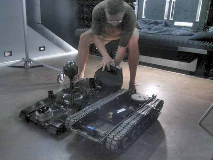 Producer Tom Eberts dealing with his favorite activity, robots that don't perform on cue.