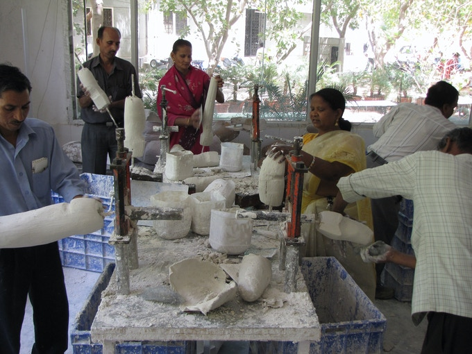 Technicians making casts in the plaster-of-Paris workshop