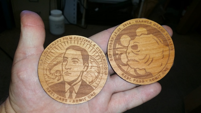 Front and back of Reel Pass. Art by Steven Santiago