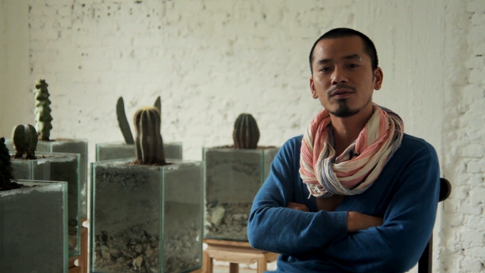 Mami, of Nha San Collective, poses with his cacti installation.
