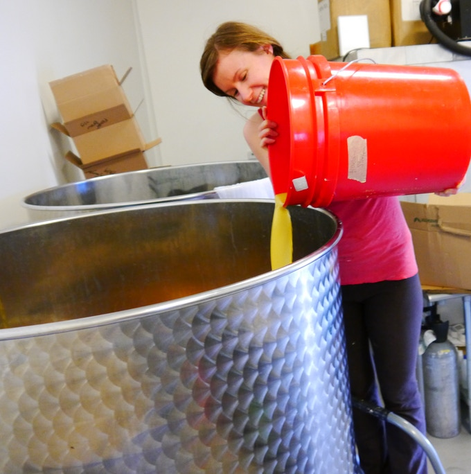 Danielle prepares a batch of our Living Ginger with fresh-pressed ginger juice