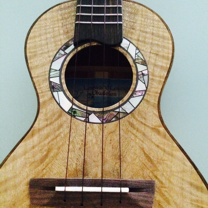 Uncle Fred made this ukulele.  Notice the lovely shell rosette he crafted. Mahalo uncle Fred!