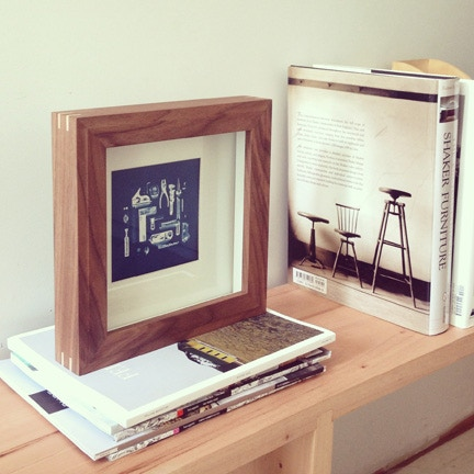 "Workshop frame in walnut with ash splines. Cyanotype photograph of Workshop tool arrangement by Kate Sears. 10""x10"" frame."