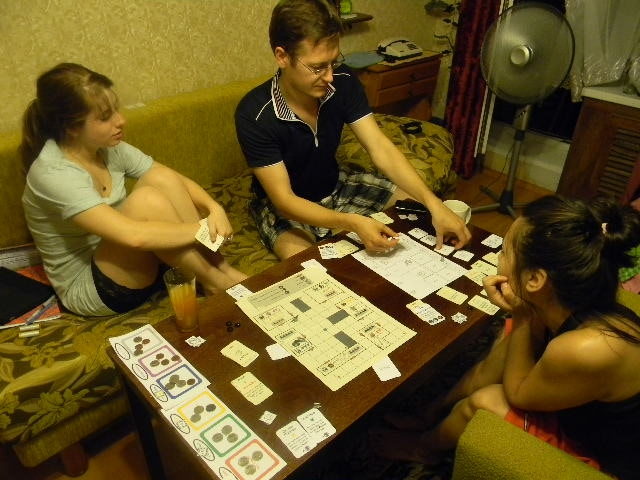 Samantha, Adam, and Ksenia playtesting an early version of the game