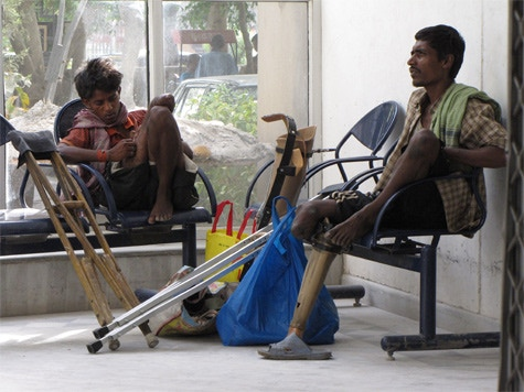 Two young men wait in the reception area at Jaipur