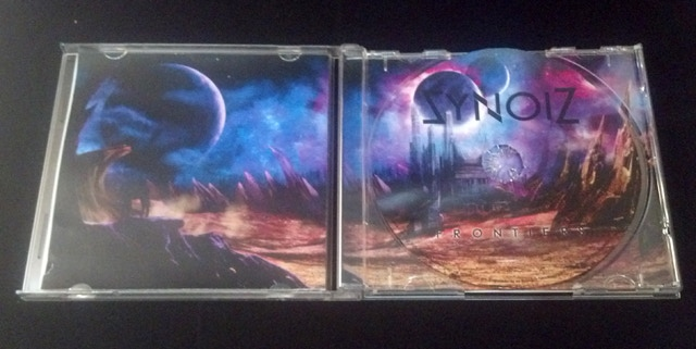 Test copy of the Frontiers CD inlay + CD in jewelcase