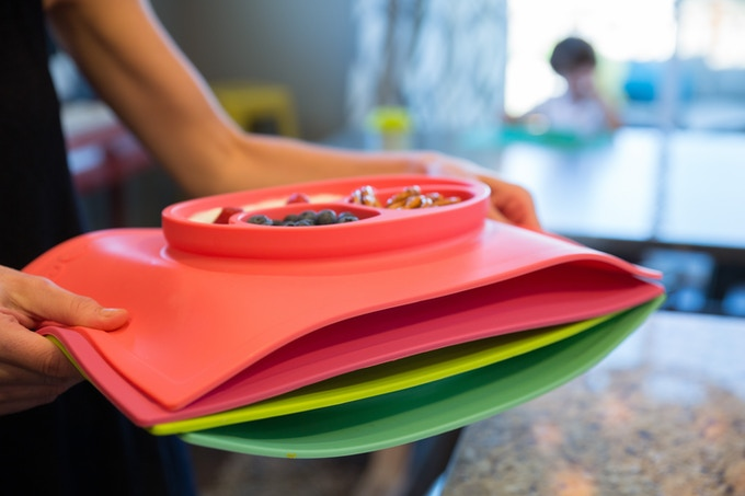 The silicone is sturdy, which means you can carry the mat + food to the table. You can also stack 3-4 mats with food for the whole family, plus friends!