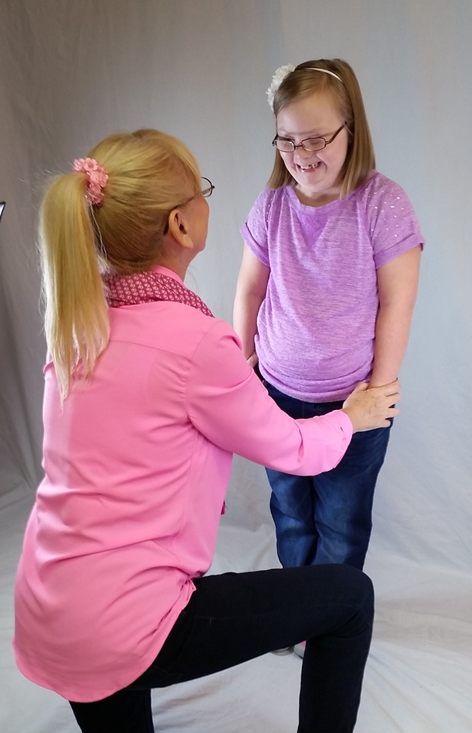 """Maggie sharing a special moment with grandma during her photo shoot wearing her namesake """"Maggie"""" jeans."""