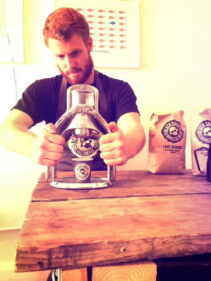 Ben is making a Robusta Revival espresso using our very own handpresso in Camden