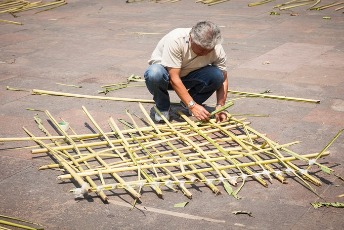 Weaving a skin panel, banana leaf veins fastened with packing tape, Tlatelolco, Mexico City.