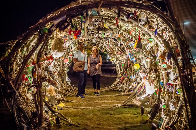 Participants in Jackson, Mississippi walk through illuminated COCOON looking at little cocoons and listening to recorded testimony.