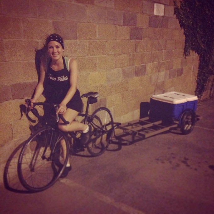 Cayla Mackey, owner of Taco Bike, with a Surly Bill trailer