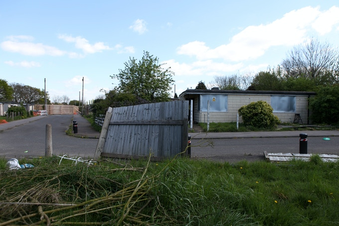 Boarded up prefab, ready for demolition, April 2014