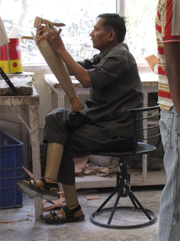 Mr.Todarmal, the Head Cobbler, who makes all the leatherwork for the prosthetic limbs - and has two himself.