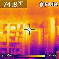 Thermal camera, yellow is warmer, blue is colder.  75 degrees at the ceiling 25 feet from gas heating stove