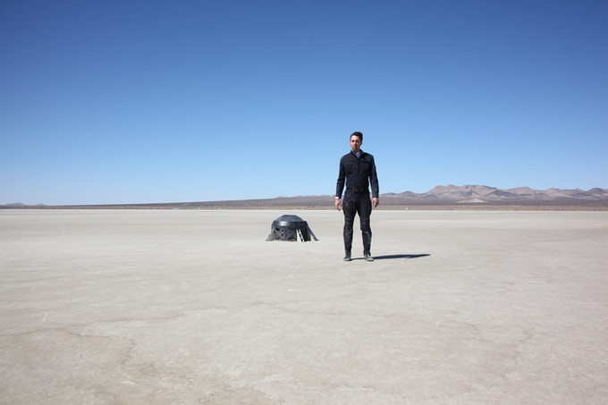 Christopher Soren Kelly next to the escape hatch in the Mojave Desert.