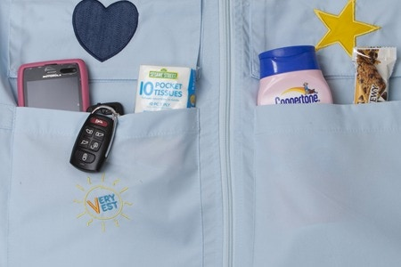 At the bottom of the vest are two extra-large pockets for you because you need a place with easy access for your essentials such as a cell phone, keys, Kleenex, sunscreen and snacks.
