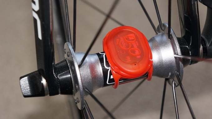 VeloComputer 9-axis Smart Sensor on a wheel hub for speed and acceleration