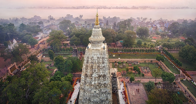 Art photo taken at dawn during the monks procession around the Mahabodhi Temple with river in background. Color work by Thomas Yeshe Dalarud. Click for details.