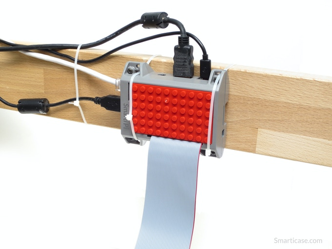 The SmartiPi allows you to thread zip-ties to mount to a variety of surfaces. This gives you the flexibility of positioning your Pi without screwing into the surface.