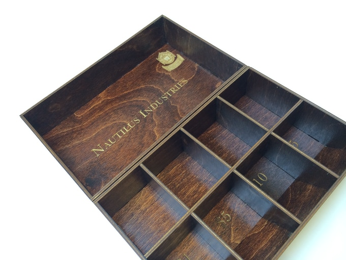 If you want to add one of these custom wood inserts to your pledge please add $20 in North America, $30 for the EU and $40 for the rest of the world.