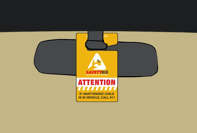 The public-facing side is also printed in traffic-sign bold coloring and requests that any passerby look into the car for an unattended child and call 9-11 if one is found.