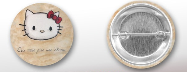 """The Treachery of Kitties"" Button Mock-Up"