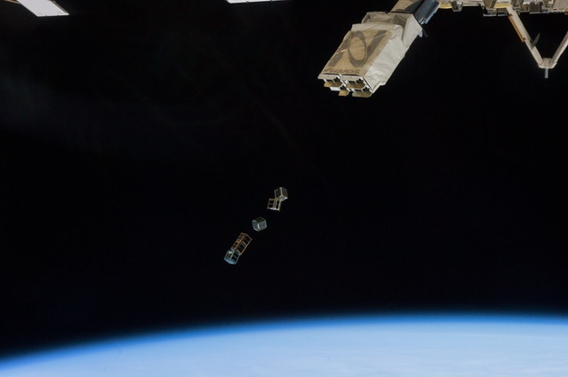 """SkyCube deployment from ISS, 28 Feb 2014.  SkyCube is the middle satellite in the """"train."""""""