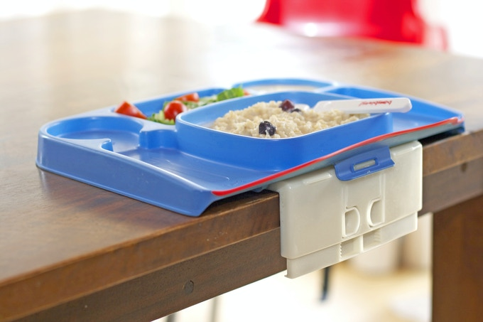 Lock-on Table Tray has a spill-catch soft lip, plate/bowl/utensil/cup sections and an Animal Pal to engage little ones.