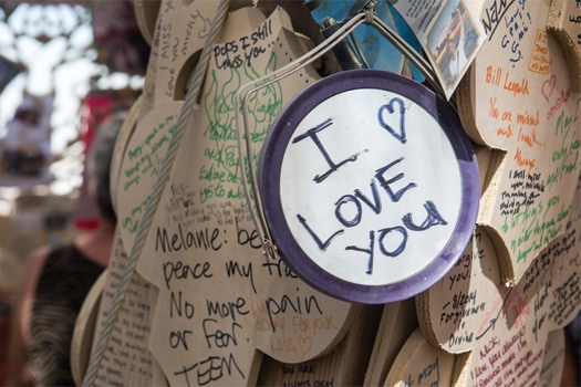 Messages left inside Temple of Grace, by David Best and the Temple Crew, Burning Man 2014. Photo by Luke Szczepanski.