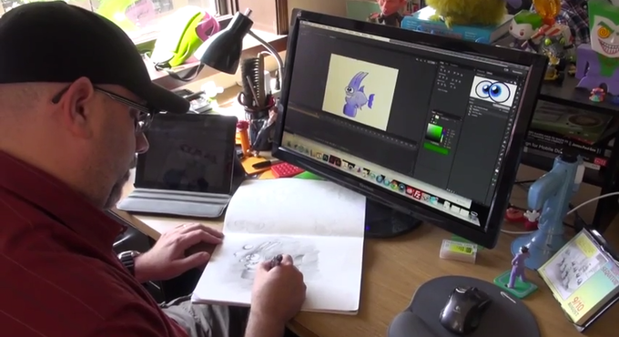 John Lucas, Primal Math's Art Director, works on character designs to be animated.