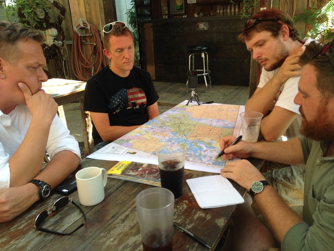 Haeg, Pearson, Woodhouse and Ingram examine a map during a meeting of the Panorama team. Photo by Dylan Smith