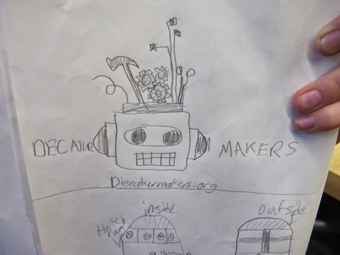 Young maker Grace draws her vision of our logo!